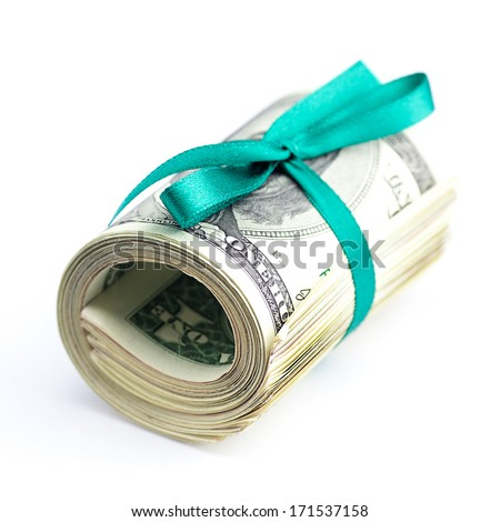 Dollars rolled into a tube tied with ribbon isolated on white - stock photo