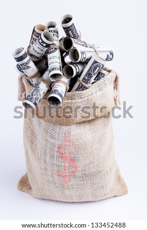 Dollars rolled up with rubber band in Sack brown isolated on white background - stock photo