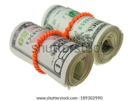 dollars rolled up with rubberband isolated on white