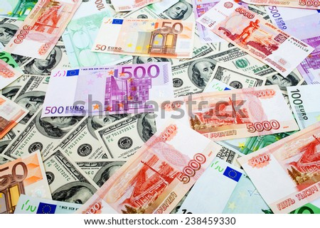 Dollars, Russian roubles and Euro background - stock photo