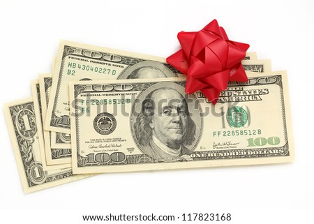 Dollars with decorative bow on white - stock photo