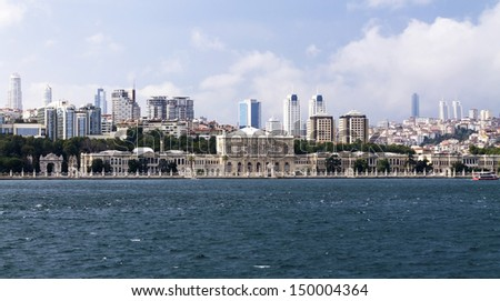 Dolmabahce Palace on city background, Istanbul, Turkey.