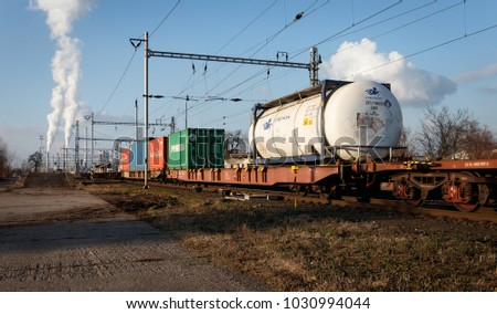 Dolni Berkovice, Czech Republic / February 13, 2018 -  Cargo (freight) train going on the track.