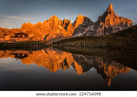 Dolomites Alps in Italy, Pale di San Martino reflecting on water near Baita Segantini, landscape - stock photo