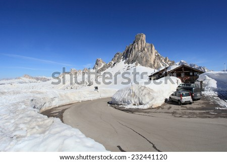 DOLOMITES, ITALY - APRIL 7, 2014: Passo Giau on April 7, 2014 in Dolomites, Italy. With an elevation of 2236m, this high alpine mountain road is a landmark scenic route on Dolomites Alps.  - stock photo