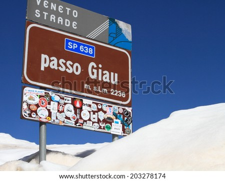 DOLOMITES, ITALY - APRIL 7, 2014: Signpost of Passo Giau on April 7, 2014 in Dolomites, Italy. With an elevation of 2236m, this high alpine mountain road is a landmark scenic route on Dolomites Alps. - stock photo