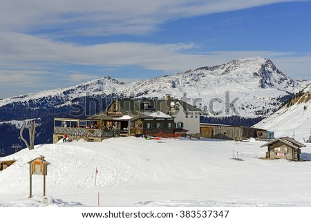 "DOLOMITES, ITALY - FEBRUARY 22, 2016: Mountain chalet ""Capanna Cervino"" of Passo Rolle (Pass Rolle). The Pala group, Mountain range in the Dolomites, Italy. UNESCO World Heritage Site"