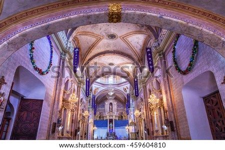 DOLORES HIDALGO,, MEXICO - DECEMBER 29, 2014 Christmas Arches, Parroquia Cathedral Dolores Hidalgo Mexico. Cathedral built in the 1700s.  Signs say Christmas sayings such as Advent, Love, Joy, Hope.  - stock photo