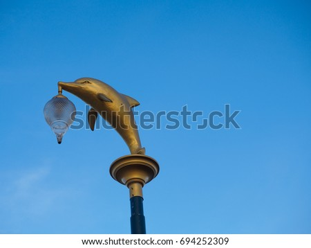 Dolphin Lamp In Blue Sky.