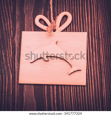 Dolphin on an old wooden background - stock photo