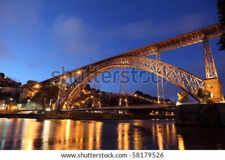 Dom Luis I Bridge illuminated at night. Oporto, Portugal - stock photo