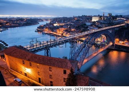 Dom Luis I Bridge over Douro river between city of Porto and Vila Nova de Gaia in Portugal at twilight. - stock photo