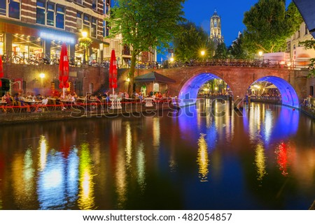 Dom Tower and canal Oudegracht in the night colorful illuminations in the blue hour, Utrecht, Netherlands