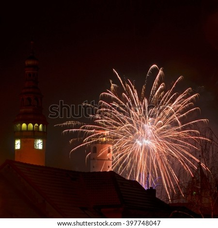 DOMAZLICE, CZECH REPUBLIC, Europe - January 1, 2015: Domazlice -view on tower of church. Domazlice - Night view on tower of castle with fireworks,new year. Doamlice and fireworks. Editorial photo.