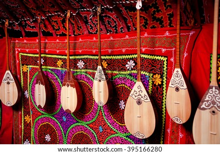 Dombra string instruments on the wall of Kazakh yurt at Nauryz celebration in Almaty, Kazakhstan