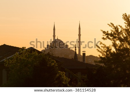 Dome and minaret of a mosque in Istanbul on a sunset, Turkey - stock photo