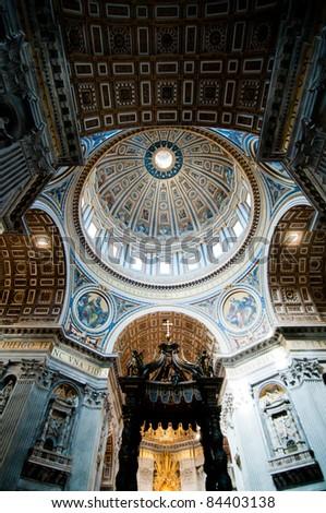 Dome in St. Peter's Basilica and Bernini's Baldacchino - stock photo