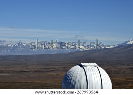Dome of Mount John University Observatory building, near high mountains range in New Zealand. - stock photo