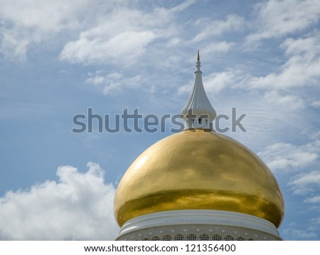 Dome of the Omar Ali Saifuddien mosque, in front of a blue sky in Bandar Seri Begawan in Brunei, Borneo. - stock photo
