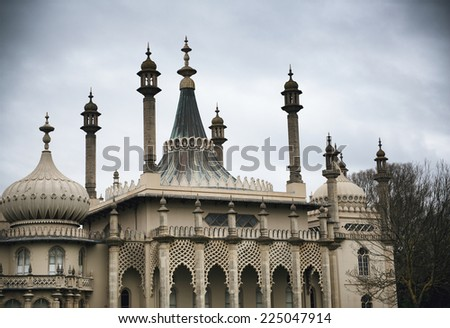 Dome Rooftops of Brighton Royal Pavilion Former Royal Residence Under Cloudy Skies in Brighton, England - stock photo