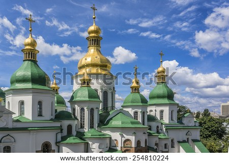 Domes and crosses of St. Sophia Cathedral (Eastern Orthodox Cathedral, 11th century). View from Bell Tower. Sophia Cathedral - UNESCO World Heritage Site. Kiev, Ukraine. - stock photo