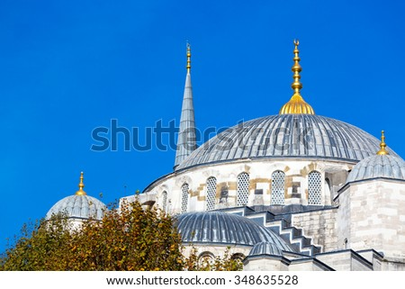 Domes and Minarets of Sultan Ahmed Mosque in Istanbul city Famous historical building Example of Middle Eastern Muslim Architecture - stock photo