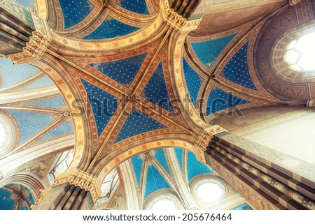 Domes in gothic cathedral interior - stock photo