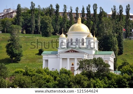Domes of a Church in Nizhny Novgorod, Russia in summer with trees