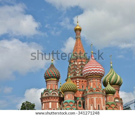 Domes of St. Basil's Cathedral on red square in Moscow. The dome of the Cathedral, lit by the sun against the blue sky.