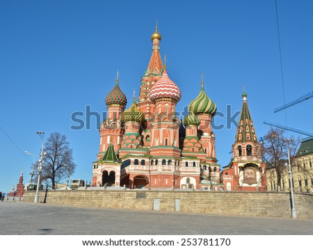 Domes of St. Basil's Cathedral on red square. The St. Basil's Cathedral in Moscow's red square, illuminated by the sun.