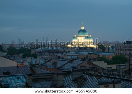 Domes of Trinity Cathedral and rusty roofs at night in Saint Petersburg, Russia