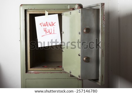 Domestic burglary. Safe box armoured emptied by thieves with message of thanks on paper: THANK YOU.