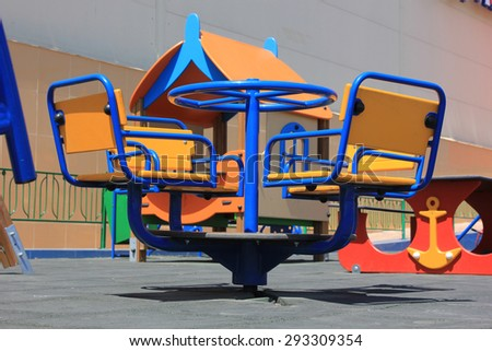 Domestic children's roundabout with wooden seats on 4 people - stock photo