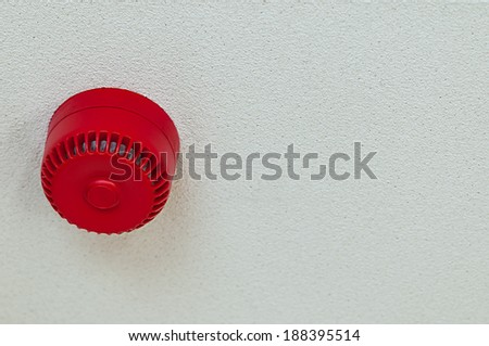 Domestic fire alarm sound alert red round ceiling  - stock photo