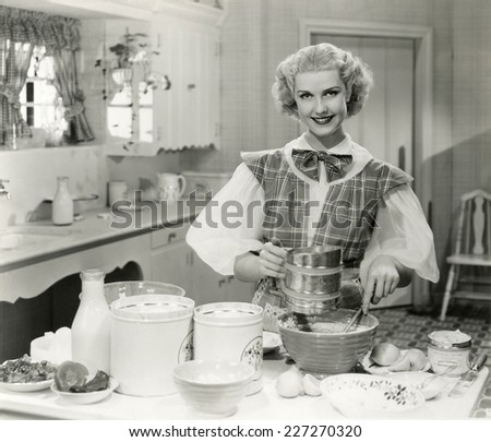 Domestic goddess baking in the kitchen - stock photo