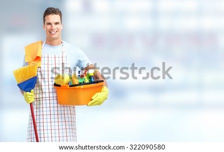 Domestic housekeeping service man janitor. Home cleaning. - stock photo