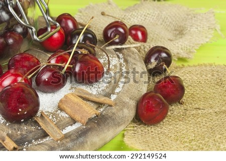 Domestic production of cherry jam. Freshly picked cherries ready for canning. The supply of fruits for the winter and a rainy day. The preparation of sweets for the family. - stock photo