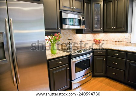 Domestic style kitchen empty of people or clutter - stock photo