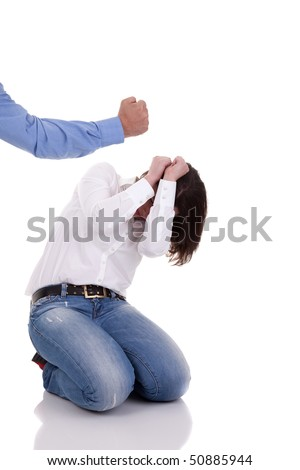 domestic violence: hand of a man, hitting a woman who cringes, isolated on white background