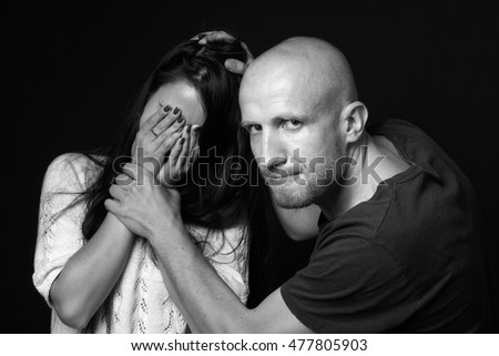 Domestic violence to woman, black background