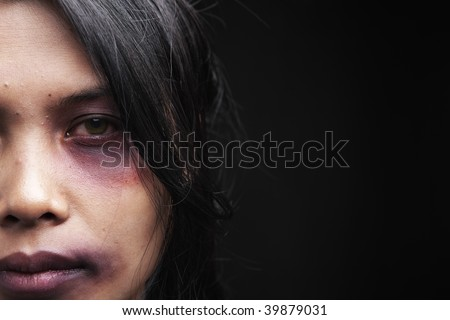 Domestic violence victim, a young Asian woman being hurt - stock photo