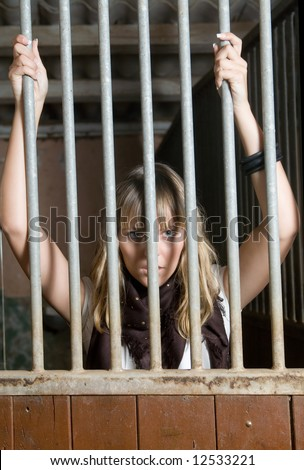 Domestic violence with a prisioner woman - stock photo