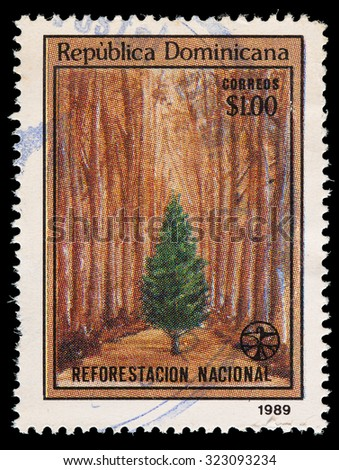 DOMINICAN REPUBLIC - CIRCA 1989: A postage stamp printed in Dominican Republic shows a tree in a forest for the National reforestation campaign, circa 1989 - stock photo