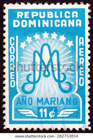 "DOMINICAN REPUBLIC - CIRCA 1954: A stamp printed in Dominican Republic from the ""Marian Year "" issue shows emblem, circa 1954.  - stock photo"