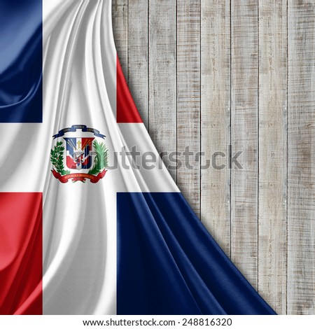 Dominican Republic flag and wood background - stock photo