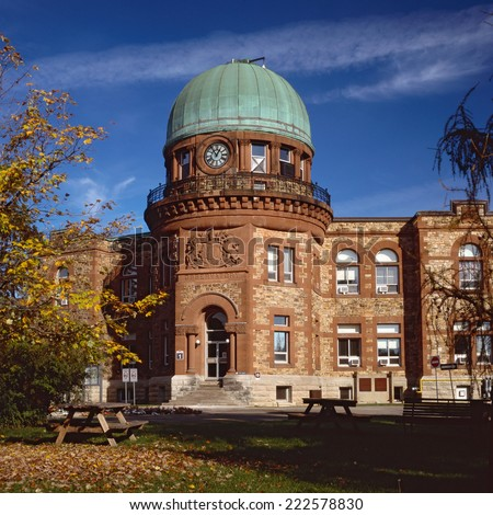 Dominion observatory building, built in 1902, stands in the central experimental farm lands in Ottawa Ontario. High resolution medium format film image. - stock photo