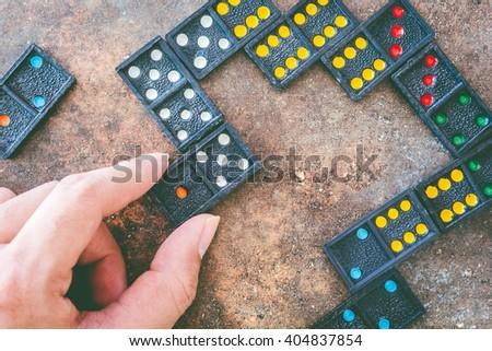 Domino bones composition on stone background - stock photo