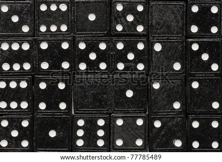 Domino cards fill a table. Rectangle of dominoes tilled on a table - stock photo