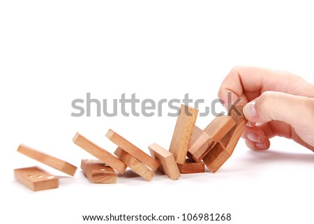 domino falling on white background - stock photo