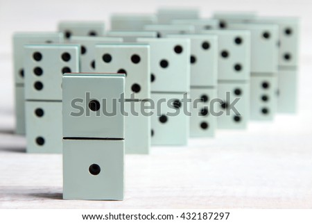 Domino on a white wooden background